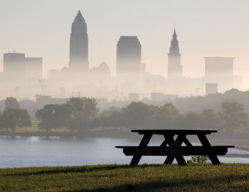 Cleveland skyline seen through fog with picnic bench in foreground