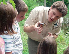 Lake Metropark guide showing turtle to children