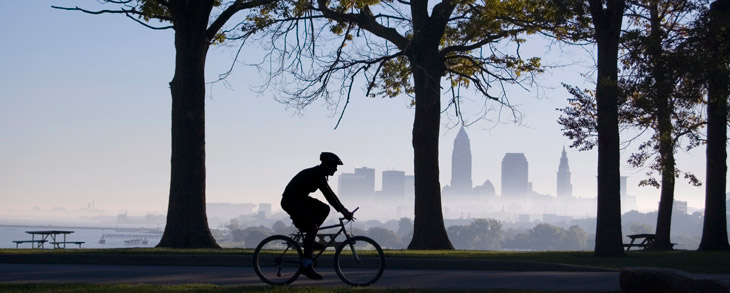 Silhouette of biker with cleveland skyline in background