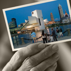 Detail of 2009 Report to Community Cover. Elderly hand holding color photograph of downtown Cleveland.