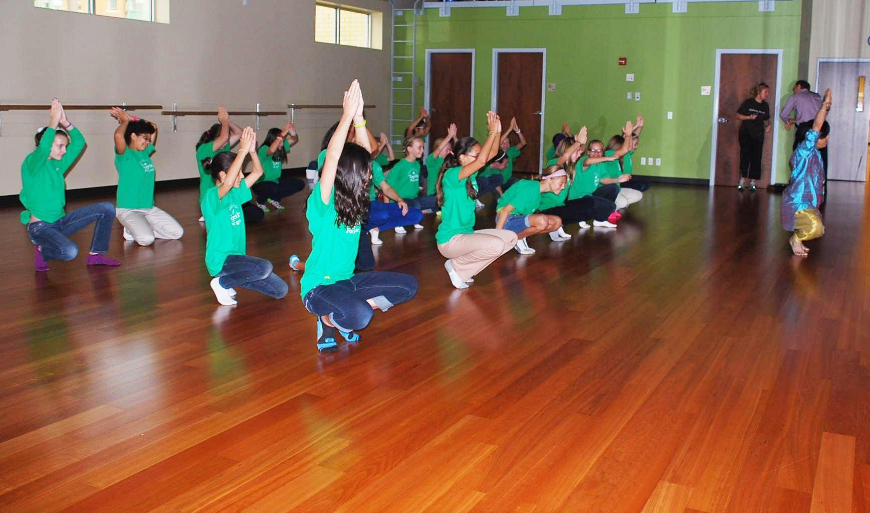 Students warm up before dance class