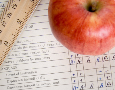 Apple, ruler, and report card