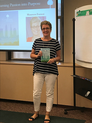 Photo of Maureen Forrest standing with her glass TPIP award