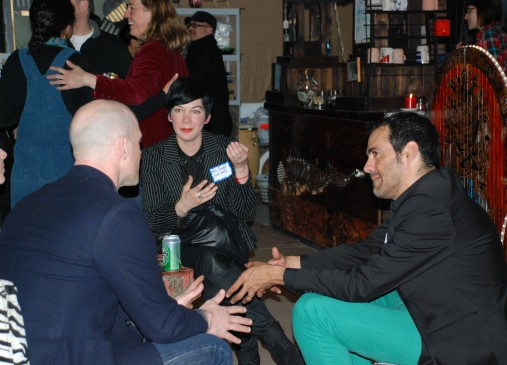 Mely Barragan, center, and Daniel Ruanova, right, who together operate studios in Mexico and China, talk with local artist Jason Lehrer at the Negative Space Mixer.