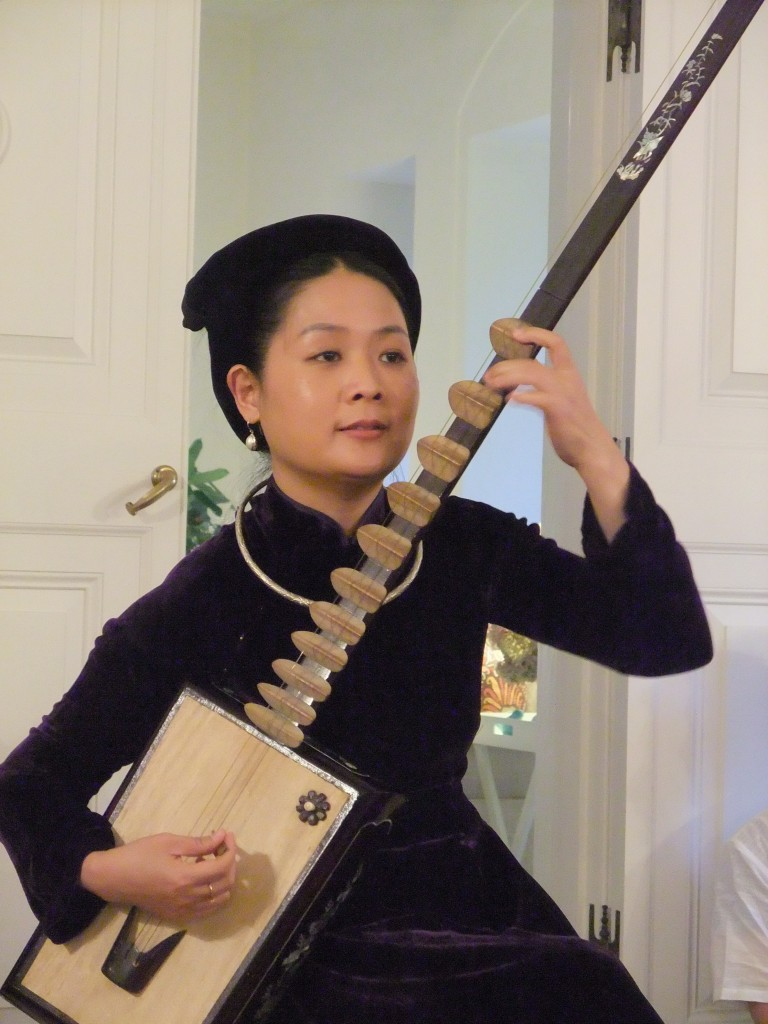 Pham Thi Hue plays the Ty Ba, a  traditional Vietnamese string instrument.