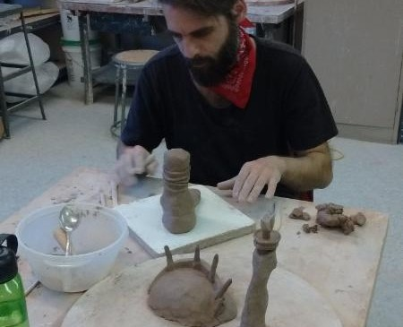 Nico Grum creating clay sculptures.png