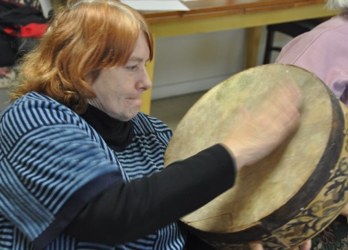 Nancy Dier tries out a drum from Kuula s collection