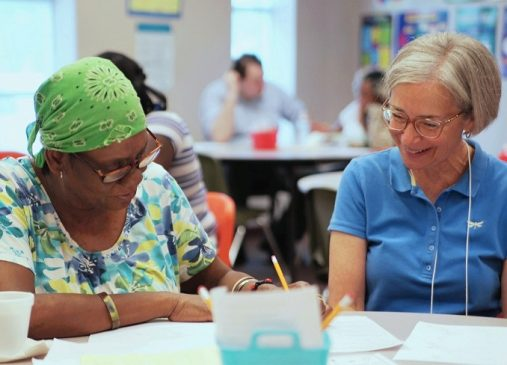 Two adults in literacy tutoring workshop at Seeds of Literacy Cleveland