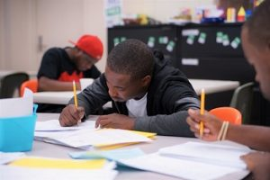 Man works on literacy exercises at Seeds of Literacy in Cleveland