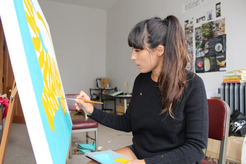 Michela Picchi paints canvases in her Hingetown studio when she's not working on her mural.