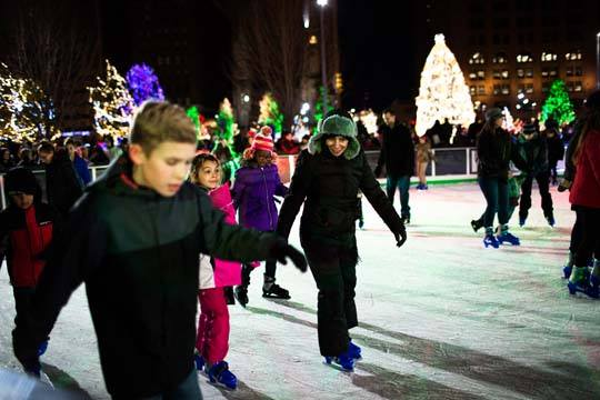 Youth ice skating at night on Cleveland Foundation Skating Rink in Public Square