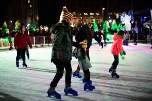Family skating on Cleveland Foundation Ice Rink in Public Square