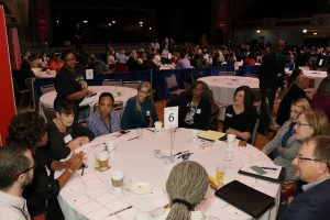 Greater Cleveland Caucus attendees in conversation around a table