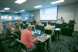 Students listen to professor in computer science class