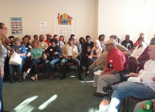 A group of residents seated around the room during a Neighborhood Connections meeting