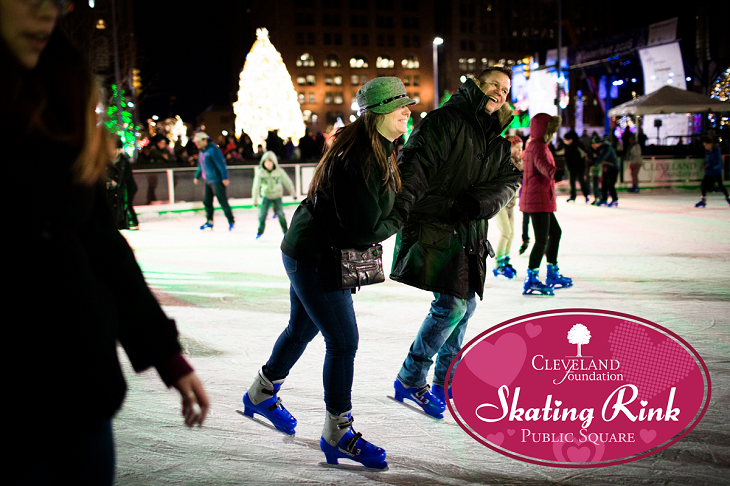 A man and woman skate on Cleveland Foundation Skating Rink at Cleveland Public Square