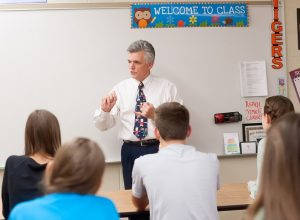 A LifeAct representative talks to a classroom of students