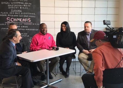 Lillian Kuri seated with other Cleveland Chain Reaction investors during an interview to announce the series.