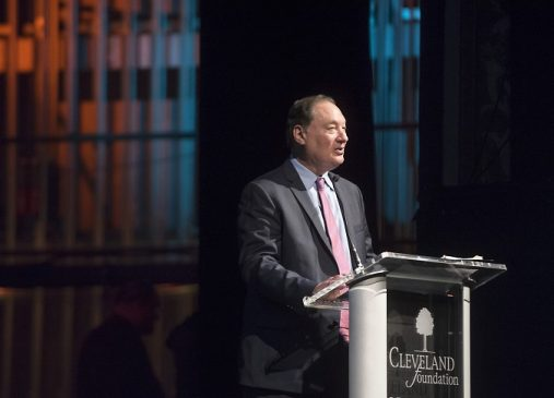 Cleveland Foundation President and CEO Ronn Richards stands at podium onstage at annual meeting