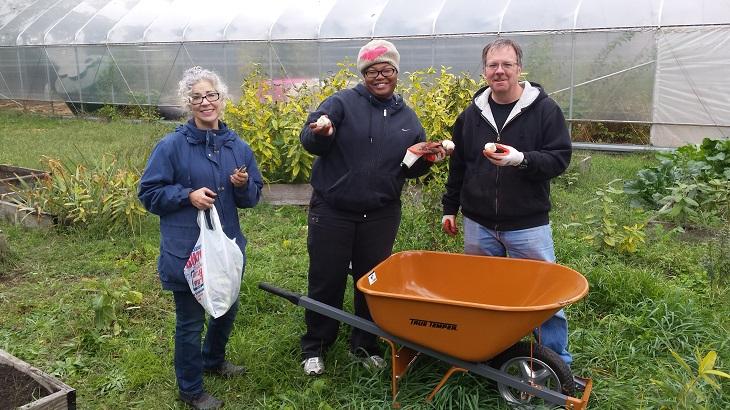Encore ACTS volunteers working in a community garden
