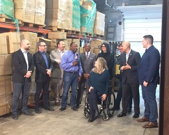 Cleveland Chain Reaction investors stand in Inca Tea warehouse to announce neighborhood