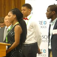 Empower Cleveland Youth program students stand at podium during kickoff event