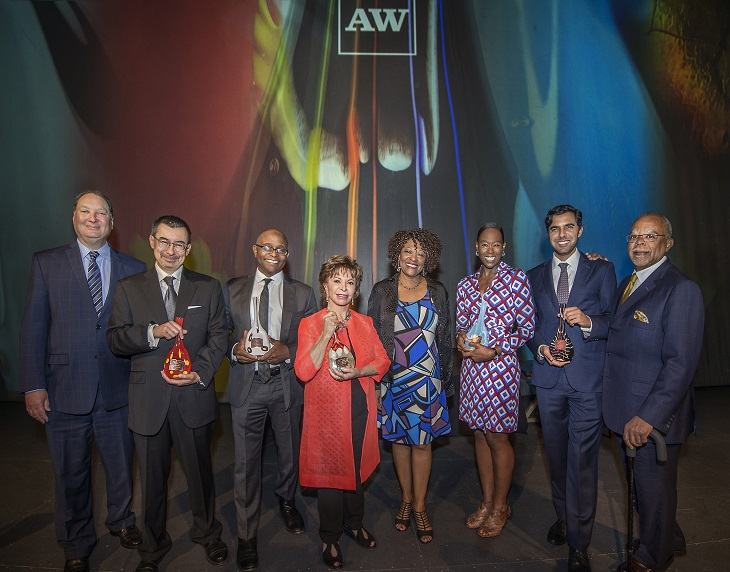 the 2017 Anisfield-Wolf winners pose with their awards alongside Cleveland Foundation President & CEO Ronn Richard and poet Rita Dove