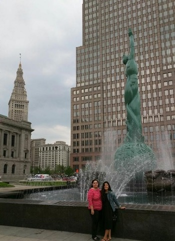 Roberta and another woman stand in front of Cleveland's Statue of Eternal Life fountain