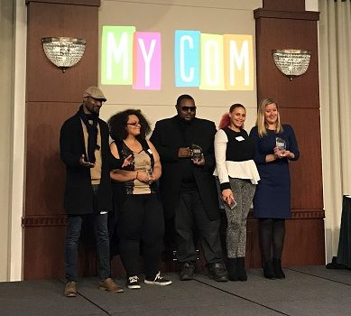 2017 MyCom Youth Voice Awards Business Award winners stand onstage with their awards