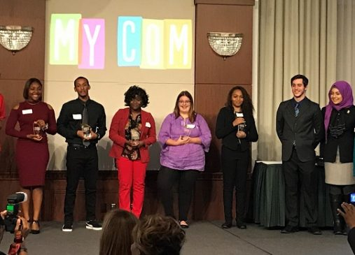 The 2017 MyCom Youth Voice Awards Youth Category winners stand onstage with their awards