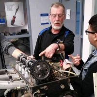WIRE-Net instructor helps students work on motor