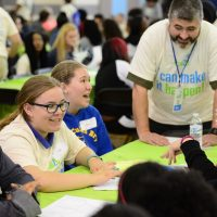 True2U mentor Patrick Gannon works with a group of students during a True2U event