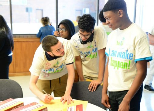 Three eight grade CMSD students wearing True2U shirts work together on an exercise