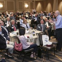 Conrad Teitell talks to a packed room at a continuing education seminar