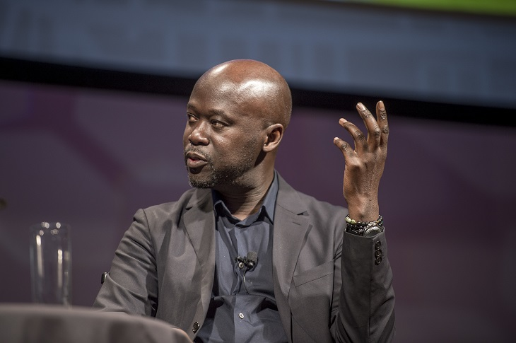 Sir David Adjaye pictured onstage at annual meeting