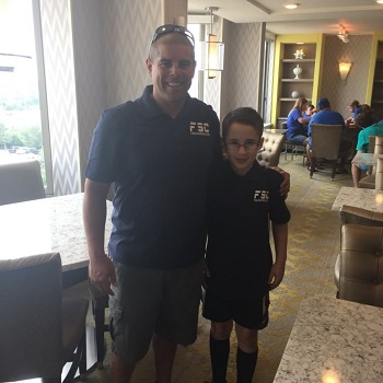 Little Frank and his Uncle Ryan pose for a picture