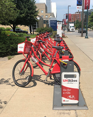 Picture of UH Bikes in stand on sidewalk
