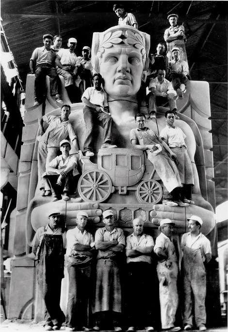 Black and white image of workers who built the Hope Memorial Bridge standing next to one of its statues