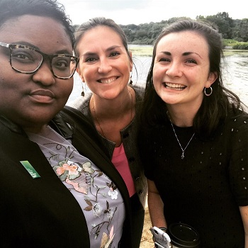 Caitlin Matthews pictured with two other women in front of river