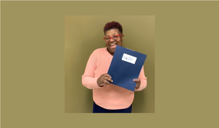 Michelle Madison poses with a Womens Business Center Folder