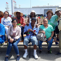 Hakmat and a group of seniors at the Tall Ships Festival
