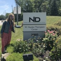 Agnes stands next to New Directions sign