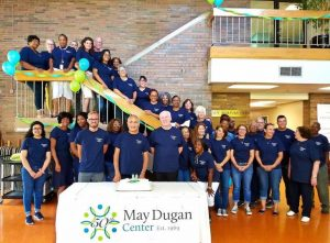 May Dugan staff pose for a group picture