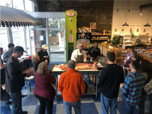 EDWINS graduates lead a butchery class for local residents at EDWINS Butcher Shop.