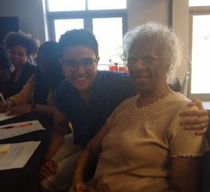 Cristina poses with a resident at Eliza Bryant Village