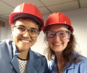 Cris and a fellow intern pose in hard hats