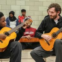 cleveland classical guitar instructor with student