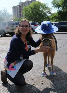 Audra poses with mini horse