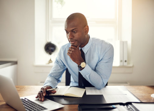 Man sits in front of laptop