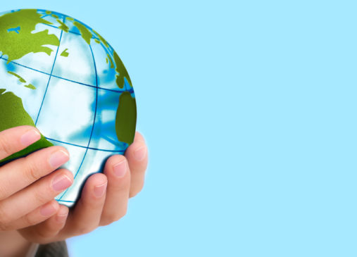 Image of person holding small globe